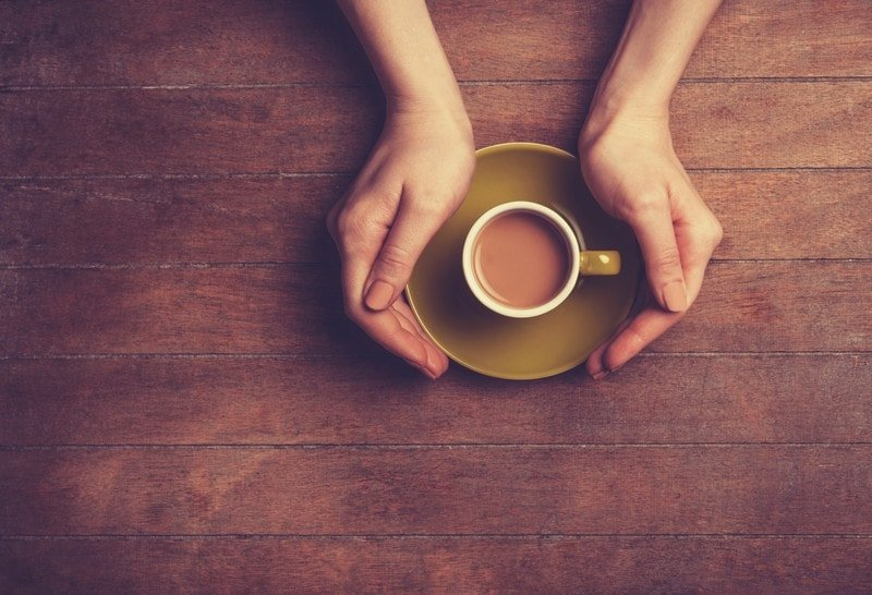 coffee cup with hands