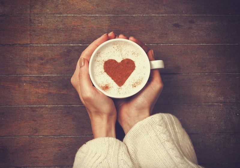 coffee cup with heart and hands