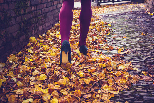 woman legs and leaves featured image